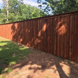 Board on Board Cap and Trim Stained Fence