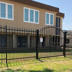 Commercial Black Iron Fence with a Sign at the Front of Business Property in Arlington/Fort Worth, TX