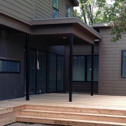 New cedar deck with iron poles