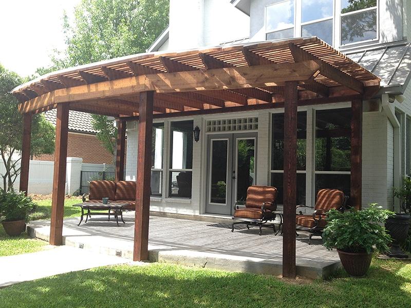 Cedar stained pergola over patio
