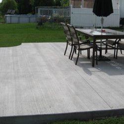 Concrete backyard entertainment space