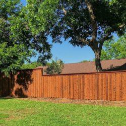 Cap and trim cedar board on board fence