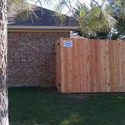 Side by side dog eared cedar fence