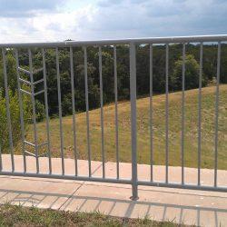 Custom iron fence with arrow design