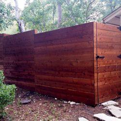 Horizontal stair step cedar fence with gate