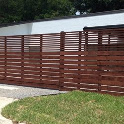 Custom horizontal cedar fence with sliding gate