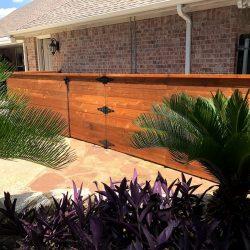 Horizontal wood pool equipment fence