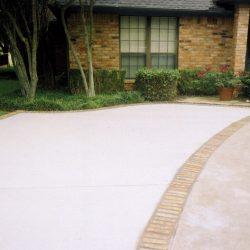 Concrete driveway with brickwork