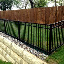 Iron fence and cedar fence