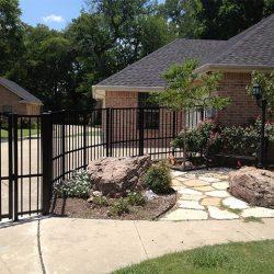 Iron fence around driveway