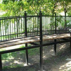Wrought iron bridge with cedar boards