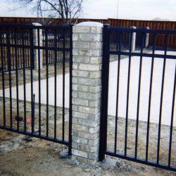 Iron fence with masonry work