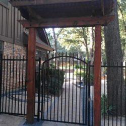 Cedar arbor over iron gate