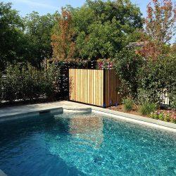 Cedar fence pool equipment enclosure