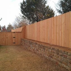 Side by side natural cedar fence