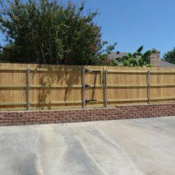 Cedar fence built on top of flagstone wall