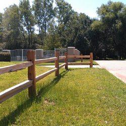 Two rail ranch style cedar fence
